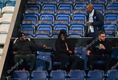 Chris Ramsey QPR coach greets former QPR player Eberechi Eze (centre) in the stands