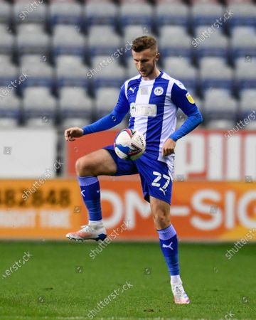 Tom James (27) of Wigan Athletic controls the ball