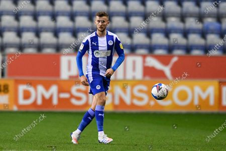 Tom James (27) of Wigan Athletic looks for a pass