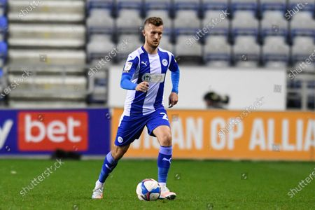 Tom James (27) of Wigan Athletic runs forward with the ball