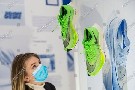"""A staff member views the """"Nike Zoom X Vaporfly NEXT%"""" running shoes by designers at Nike Sport Research, as worn by Eliud Kipchoge to break the two hour marathon barrier. Preview of the Beazley Designs of the Year at the Design Museum in Kensington. The most innovative designs from January 2019 to the moment the COVID-19 pandemic took hold are on display 21 October to 28 March 2021."""