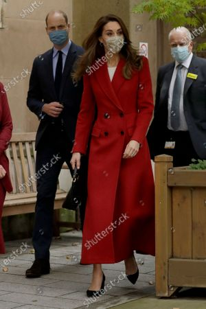 Britain's Prince William and his wife Kate the Duchess of Cambridge arrive as they visit St. Bartholomew's Hospital in London, to mark the launch of the nationwide 'Hold Still' community photography project, . The Duke and Duchess of Cambridge on Tuesday met a small number of staff from the hospital, including pharmacist and photographer Joyce Duah and the two pharmacy technician colleagues she photographed writing on their PPE as they put it, in a photograph that was selected to be in the set of 100 images taken during the coronavirus lockdown