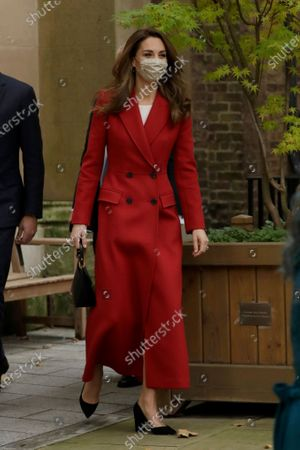 Britain's Kate the Duchess of Cambridge arrives as she and her husband Prince William arrive to visit St. Bartholomew's Hospital in London, to mark the launch of the nationwide 'Hold Still' community photography project, . The Duke and Duchess of Cambridge on Tuesday met a small number of staff from the hospital, including pharmacist and photographer Joyce Duah and the two pharmacy technician colleagues she photographed writing on their PPE as they put it, in a photograph that was selected to be in the set of 100 images taken during the coronavirus lockdown
