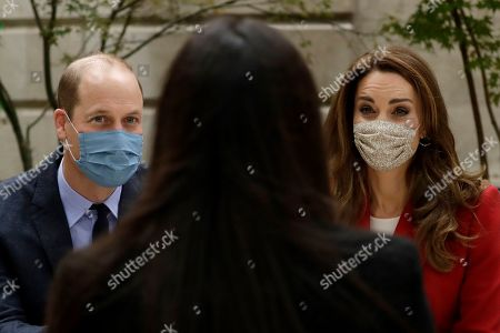 Britain's Prince William and his wife Catherine Duchess of Cambridge meet pharmacy technician Amelia Chowdhury as they visit St. Bartholomew's Hospital in London, to mark the launch of the nationwide 'Hold Still' community photography project