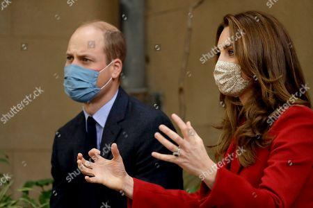 Stock Photo of Britain's Prince William and his wife Catherine Duchess of Cambridge meet medical staff as they visit St. Bartholomew's Hospital in London, to mark the launch of the nationwide 'Hold Still' community photography project