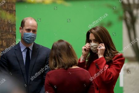 Britain's Prince William and his wife Catherine Duchess of Cambridge speak to Alwen Williams the Group Chief Executive Officer of Barts Health NHS Trust as they are greeted upon their arrival to visit St. Bartholomew's Hospital in London, to mark the launch of the nationwide 'Hold Still' community photography project