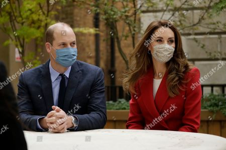 Britain's Prince William and his wife Catherine Duchess of Cambridge meet pharmacist Joyce Duah as they visit St. Bartholomew's Hospital in London, to mark the launch of the nationwide 'Hold Still' community photography project