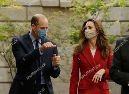 Britain's Prince William and his wife Catherine Duchess of Cambridge walk together during their visit to St. Bartholomew's Hospital in London, to mark the launch of the nationwide 'Hold Still' community photography project