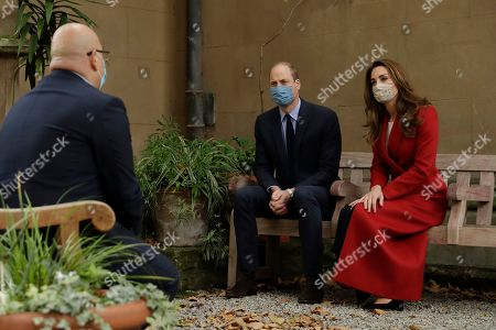 Britain's Prince William and his wife Catherine Duchess of Cambridge meet Head of Pharmacy Sotiris Antoniou as they visit St. Bartholomew's Hospital in London, to mark the launch of the nationwide 'Hold Still' community photography project