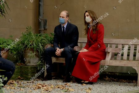 Britain's Prince William and his wife Catherine Duchess of Cambridge meet medical staff as they visit St. Bartholomew's Hospital in London, to mark the launch of the nationwide 'Hold Still' community photography project