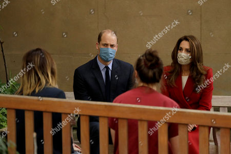 Britain's Prince William and his wife Catherine Duchess of Cambridge meet medical staff, Respiratory Physio Isobel Fale, second right, and Medical Oncology Trainee and Chief Registrar Dr Myria Galazi, left, as they visit St. Bartholomew's Hospital in London, to mark the launch of the nationwide 'Hold Still' community photography project