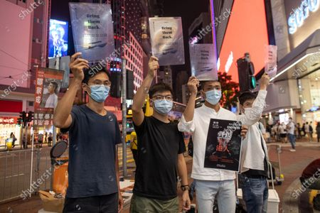 Stock Picture of Pro-democracy activist Eddie Chu, (L), Joshua Wong Chi-fung, (2R), Owen Chow, (2R), and Lester Shum, (R), distribute leaflets in Hong Kong, China, 20 October 2020. Wong took to the street to announce an online assembly in support of the 12 Hongkongers detained in Mainland China after allegedly trying to flee to Taiwan in August 2020.