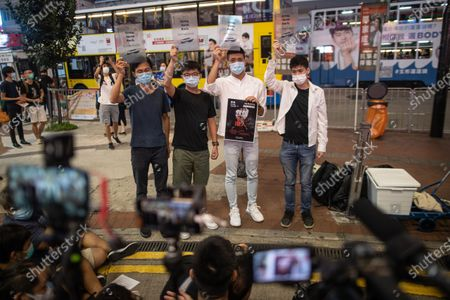 Pro-democracy activist Eddie Chu (L), Joshua Wong Chi-fung, (2R), Owen Chow, (2R), and Lester Shum (R), distribute leaflets in Hong Kong, China, 20 October 2020. Wong took to the street to announce an online assembly in support of the 12 Hongkongers detained in Mainland China after allegedly trying to flee to Taiwan in August 2020.