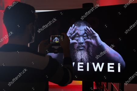 "A guest takes a picture of the Chinese contemporary artist Ai Weiwei during a press conference to announce the inauguration in Lisbon, next June, of the exhibition ""Rapture"", Lisbon, Portugal, 20 October 2020."