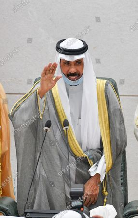 Emir of Kuwait Sheikh Nawaf Al-Ahmad Al-Jaber Al-Sabah waves after addressing the inaugural session of the new parliament term at National Assembly in Kuwait City, Kuwait, 20 October 2020.