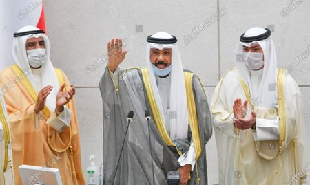 Emir of Kuwait Sheikh Nawaf Al-Ahmad Al-Jaber Al-Sabah (C) waves after addressing the inaugural session of the new parliament term at National Assembly in Kuwait City, Kuwait, 20 October 2020.
