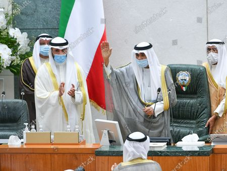 Emir of Kuwait Sheikh Nawaf Al-Ahmad Al-Jaber Al-Sabah (R) waves upon arrival to attend the inaugural session of the new parliament term at National Assembly in Kuwait City, Kuwait, 20 October 2020.