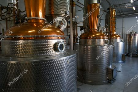 Stock Image of Spirit stills are pictured on the premises of the palinka distillery, Mynai village, Uzhhorod district, Zakarpattia Region, western Ukraine. Palinka (fruit brandy) is commonly made of locally grown fruit: plums, apricots, apples, pears, cherries, etc.