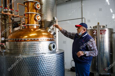 Owner of the palinka distillery Viktor Feiyer is pictured next to a spirit still, Mynai village, Uzhhorod district, Zakarpattia Region, western Ukraine. Palinka (fruit brandy) is commonly made of locally grown fruit: plums, apricots, apples, pears, cherries, etc.