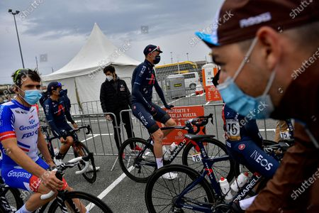 Ineos's Chris Froome, center, waits on his bicycle before starting the first stage of La Vuelta between Irun - Arrate.Eibar, 173 km, of the Spanish Vuelta cycling race that finishes in Arrate, northern Spain