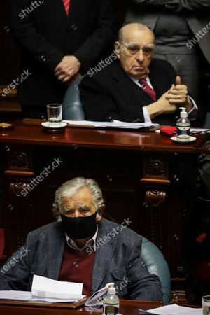 Former Uruguayan presidents Jose Mujica (below) and Julio Maria Sanguinetti (above) participate in a session of Parliament, in Montevideo, Uruguay, 20 October 2020. The former presidents of Uruguay Julio Maria Sanguinetti (1985-1990 and 1995-2000) and Jose Mujica (2010-2015) participate in an extraordinary session in which both will resign their senatorial seats. 'Because the virus threw me out, because I am 85 years old and have an immune disease. I love politics, but I love not dying even more,' Mujica reasoned to the journalists who questioned him about his withdrawal at the entrance to the Upper House. Sanguinetti and Mujica won their seats in the elections held in October 2019, but their advanced age (Sanguinetti is 84 and Mujica 85) has made them justify their absence from the rest of the legislative period, which ends in 2025.