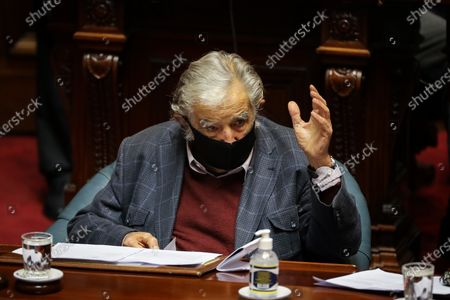 Former Uruguayan president Jose Mujica participates in a session of Parliament, in Montevideo, Uruguay, 20 October 2020. The former presidents of Uruguay Julio Maria Sanguinetti (1985-1990 and 1995-2000) and Jose Mujica (2010-2015) participate in an extraordinary session in which both will resign their senatorial seats. 'Because the virus threw me out, because I am 85 years old and have an immune disease. I love politics, but I love not dying even more,' Mujica reasoned to the journalists who questioned him about his withdrawal at the entrance to the Upper House. Sanguinetti and Mujica won their seats in the elections held in October 2019, but their advanced age (Sanguinetti is 84 and Mujica 85) has made them justify their absence from the rest of the legislative period, which ends in 2025.