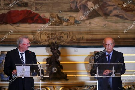 Portuguese Minister of Foreign Affairs, Augusto Santos Silva (R), flanked by his Luxembourgian counterpart, Jean Asselborn (L), talks to the press after a meeting at Ministry of Foreign Affairs in Lisbon, Portugal, 20 October 2020.