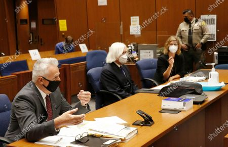 "Los Angeles County Deputy District Attorney Reinhold Mueller, left, addresses the judge along with Criminal Defense attorney Sharon Appelbaum, right, who is representing actor Danny Masterson with defense attorney Thomas Mesereau, center, during a hearing in Los Angeles Superior Court Monday October 19, 2020. ""That 70's Show"" cast member Masterson has been accused of raping multiple women at his Hollywood Hills home. Superior Court on Monday, Oct. 19, 2020 in Los Angeles, CA. (Al Seib / Los Angeles Times"