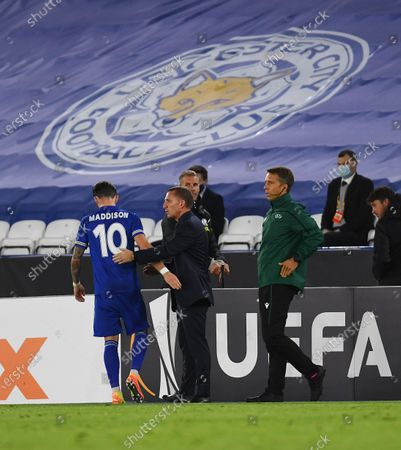 James Maddison of Leicester City is congratulated by manager Brendan Rogers after he is substituted
