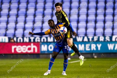 Cian Harries of Bristol Rovers challenges Daniel Udoh of Shrewsbury Town