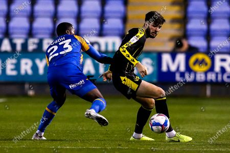 Cian Harries of Bristol Rovers takes on Daniel Udoh of Shrewsbury Town