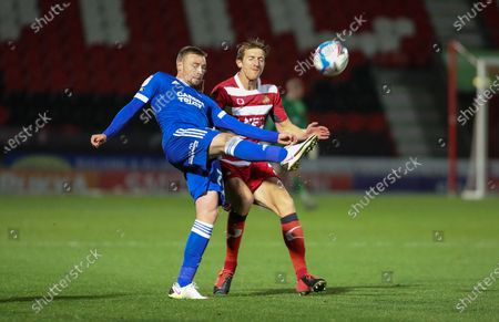 Ipswich Town forward Freddie Sears (20)  hooks the ball clear during the EFL Sky Bet League 1 match between Doncaster Rovers and Ipswich Town at the Keepmoat Stadium, Doncaster