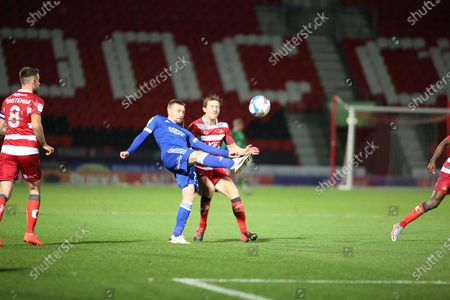 Ipswich Town forward Freddie Sears (20)  clears the ball during the EFL Sky Bet League 1 match between Doncaster Rovers and Ipswich Town at the Keepmoat Stadium, Doncaster
