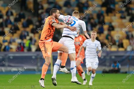 Juventus' Leonardo Bonucci jumps for a header with Dynamo Kyiv's Vladyslav Supriaha during the Champions League, group G, soccer match between Dynamo Kyiv and Juventus at the Olimpiyskiy Stadium in Kyiv, Ukraine