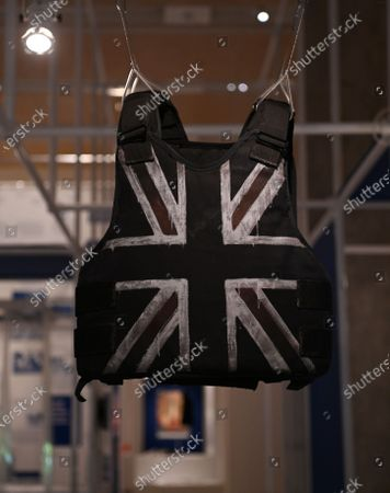 A customised stab-proof vest, designed by street artist Banksy and worn by British musician Stormzy during his performance at the Glastonbury Festival in 2019, is on display during a preview of the 'Beazley Designs of the Year' exhibition at the Design Museum in London, Britain, 20 October 2020.