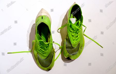 Stock Photo of A pair of Nike ZoomX Vaporfly NEXT% running shoes, a prototype version of which the shoes worn by Kenyan long-distance runner Eliud Kipchoge when he ran the Vienna Marathon in October 2019 in under two hours, on display during a preview of the 'Beazley Designs of the Year' exhibition at the Design Museum in London, Britain, 20 October 2020.
