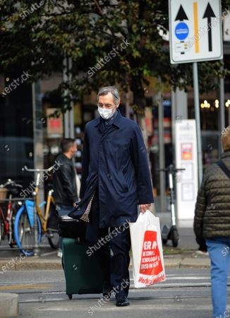 Niccolo Ghedini is seen returning home from work