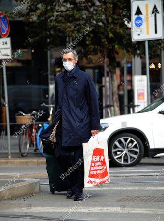 Stock Photo of Niccolo Ghedini is seen returning home from work