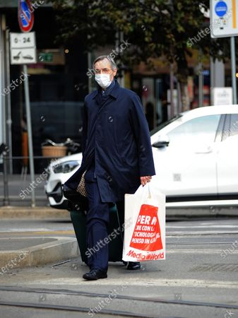 Stock Image of Niccolo Ghedini is seen returning home from work