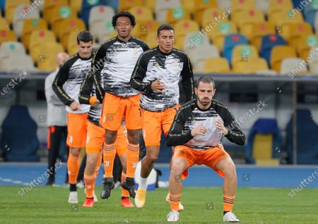 Juventus' Leonardo Bonucci (front) warms up prior to the UEFA Champions League group stage soccer match between Dynamo Kyiv and Juventus in Kiev, Ukraine, 20 October 2020.