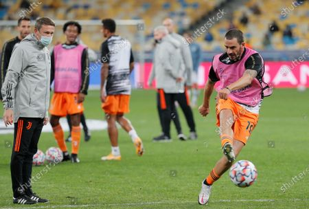 Leonardo Bonucci (R) of Juventus warms up prior to the UEFA Champions League group stage soccer match between Dynamo Kyiv and Juventus in Kiev, Ukraine, 20 October 2020.