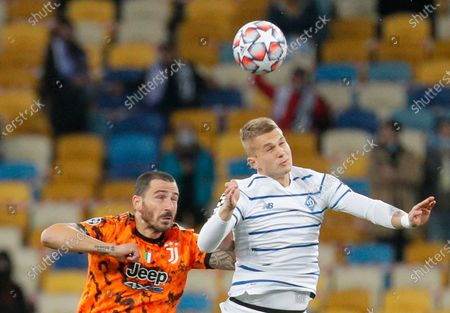 Leonardo Bonucci (L) of Juventus and Vladyslav Supriaga (R) of Dynamo Kyiv in action during the UEFA Champions League group stage soccer match between Dynamo Kyiv and Juventus in Kiev, Ukraine, 20 October 2020.