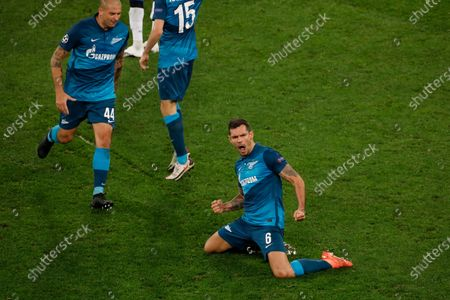 Zenit's Dejan Lovren, center, celebrates with teammates after scoring their side's first goal during the Champions League group F soccer match between Zenit St.Petersburg and Brugge at the Saint Petersburg stadium in St. Petersburg, Russia