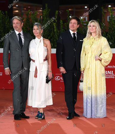 Mads Mikkelsen, his wife Hanne Jacobsen, Danish director Thomas Vinterberg and his wife, Danish actress/cast member Helene Reingaard Neumann arrive for the screening of 'Druk' (Another Round) at the 15th annual Rome International Film Festival, in Rome, Italy, 20 October 2020. The film festival runs from 15 to 25 October.
