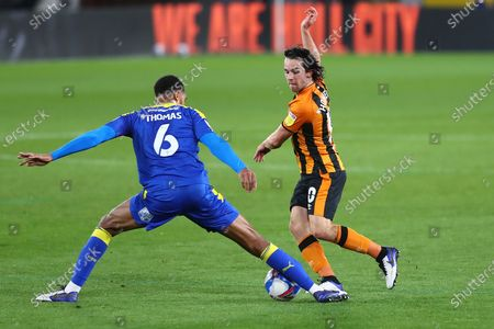Stock Image of Hull City's George Honeyman, AFC Wimbledon  Terrell Thomas during the EFL Sky Bet League 1 match between Hull City and AFC Wimbledon at the KCOM Stadium, Kingston upon Hull