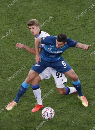 Stock Image of Charles De Ketelaere (L) of Club Brugge in action against Dejan Lovren (R) of FC Zenit St.Petersburg during the UEFA Champions League group F soccer match between FC Zenit St.Petersburg and Club Brugge in St. Petersburg, Russia, 20 October 2020.