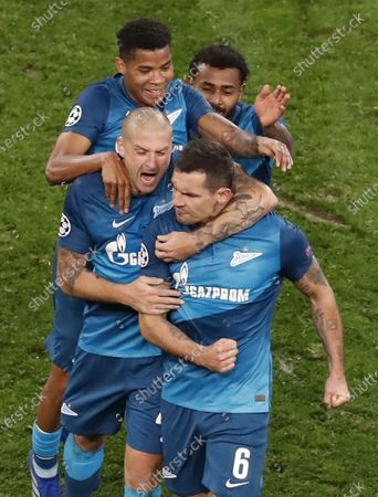 Dejan Lovren (front) of FC Zenit St.Petersburg celebrates after scoring a goal during the UEFA Champions League group F soccer match between FC Zenit St.Petersburg and Club Brugge in St. Petersburg, Russia, 20 October 2020.