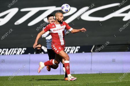 Sofyan Amrabat of ACF Fiorentina in action against Gennaro Acampora of AC Spezia