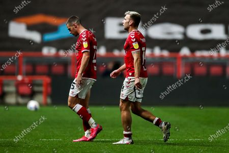 Tommy Rowe and Andreas Weimann of Bristol City looks dejected after Middlesbrough win 0-1