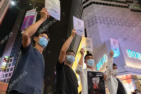"""Stock Photo of (L-R) Hong Kong pro-democracy activists Eddie Chu, Joshua Wong, Owen Chow, and Lester Shum  holding placards saying """"Bring Them Back"""" during the demonstration. Hong Kong pro-democracy activists have initiated a social media campaign in support of the twelve young protesters allegedly jailed on the mainland after a failed attempt to flee to Taiwan by a speedboat. Supporters are encouraged to take pictures of the sea through a transparent sign and upload them to social media with the hashtag """"#SAVE12""""."""
